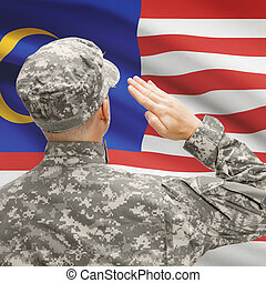 Soldier in hat facing national flag series - Malaysia -...