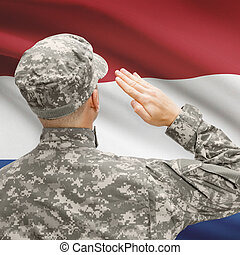 Soldier in hat facing national flag series - Netherlands -...