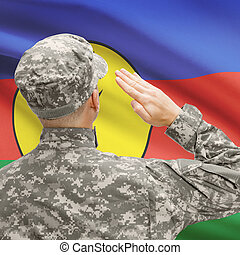 Soldier in hat facing national flag series - New Caledonia -...