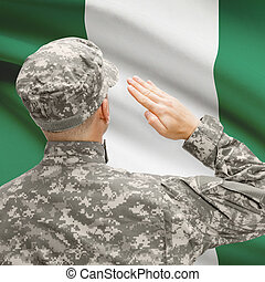 Soldier in hat facing national flag series - Nigeria -...