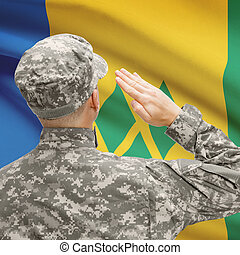 Soldier in hat facing national flag series - Saint Vincent...