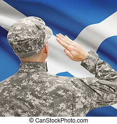 Soldier in hat facing national flag series - Scotland -...