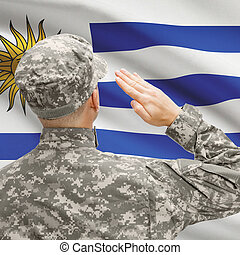 Soldier in hat facing national flag series - Uruguay -...