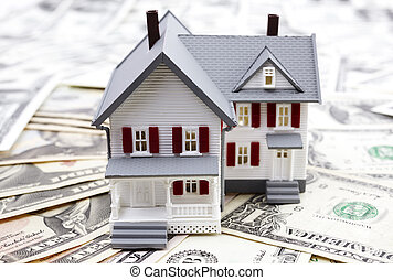 real estate - model of the house and us dollars , selective...