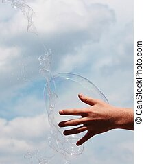 hand reach Bubbles against the sky