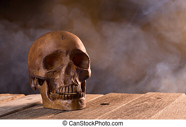 Scary Skull - Scary Halloween human skull on a smoky...