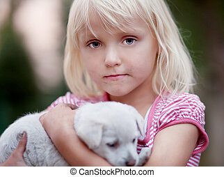 Little girl with dog.