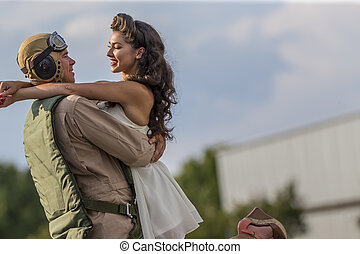 WWII Model and Airplane - A brunette model in vintage...