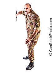 Aggressive Soldier - a soldier wearing camouflage clothing...