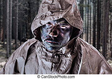 Elite Soldier - a soldier wearing a poncho o raincoat and...