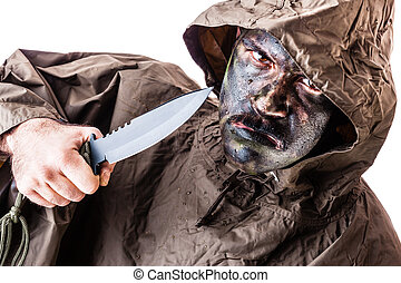 Jungle warrior - a soldier wearing a poncho or raincoat and...