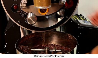Roasting coffee beans on a large frying pan - Roasting...
