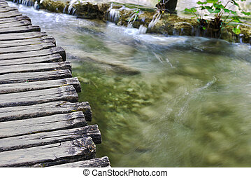 Wooden bridge  for crossing over an  water surface of lakes