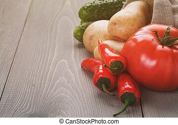 organic raw vegetables on wood table, vintage toned