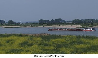 Cargo ship with metal scrap downstream the River Waal near...