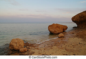 Beautiful seascape. Sea and rock at the sunset. Red sea, Egypt.