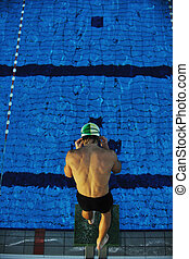 young swimmmer on swimming start