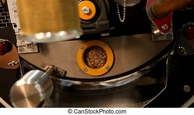 Roasting coffee beans on a large frying pan