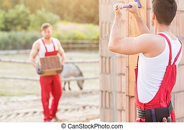 Male construction worker - Two male construction workers at...