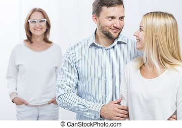 Husband, wife and mother-in-law - Picture of smiling...