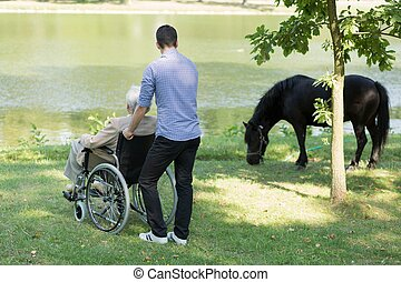 Disabled grandfather with his grandson