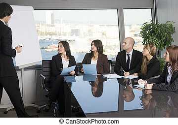Business meeting - Businesspeople are discussing the work,...