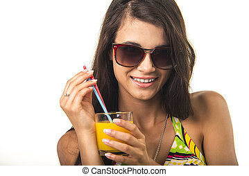 Pretty lady with orange juice. - Charming girl is holding...