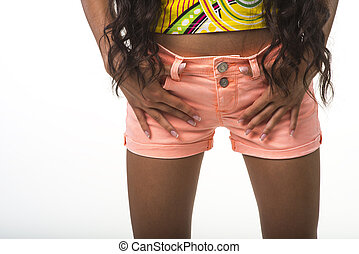 Lady in the pink shorts closeup. - Young girl is standing on...