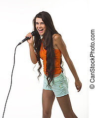 Mischievous woman in orange shirt with microphone. - The...