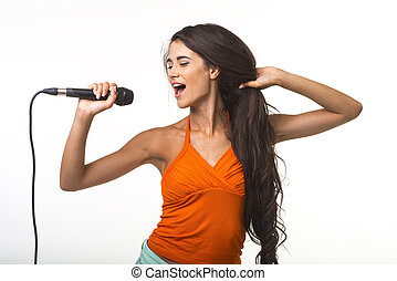 Pretty lady in orange shirt with microphone. - The brunette...