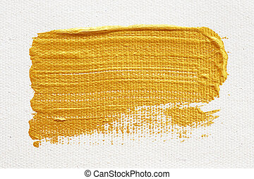 Strokes of gold acrylic paint isolated on white background