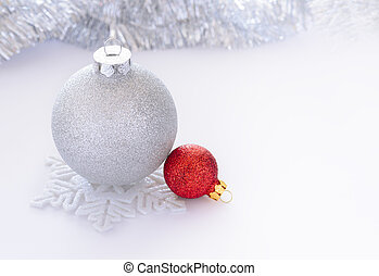 White and Red Christmas Balls on the White Background whith Space for Text