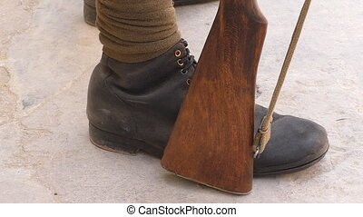 Soldier feet and rifle - Close up of around 1910 year or WW1...