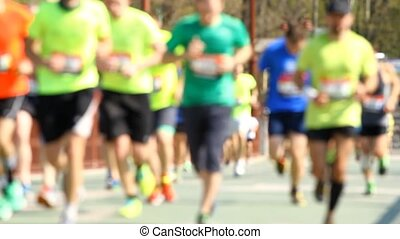 Blurred mass of a people marathon running