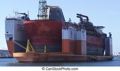 Heavy lift vessel Dockwise Vanguard berthed, carrying Armada...