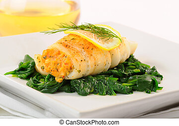 Sole - Delicious sole stuffed with crab on spinach.