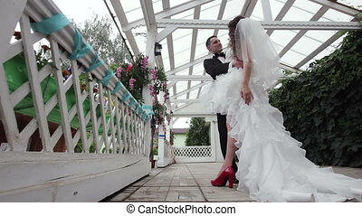 Groom holds his bride in his arms . - groom inclines the...