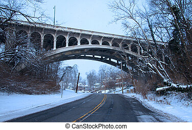 Historic arched bridge in the downtown Cincinnati on a snowy...