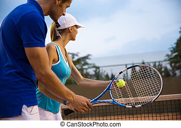Couple playing in tennis - Portrait of a couple playing in...