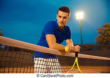 Portrait of a handsome male tennis player
