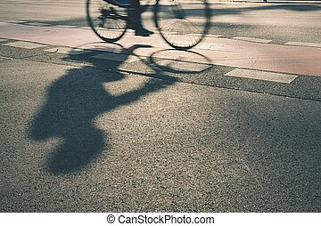Cyclist - Silhouette of cyclist on the street at sunrise