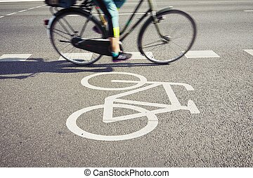 Cyclist on the cycle lane - blurred motion