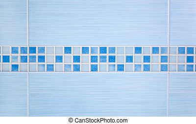 Blue tiles with row mosaic assembled on the bathroom wall