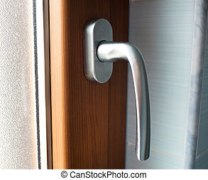 Window handle with faux wood frame - Close up of window...