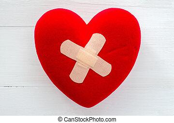 Broken heart with plaster