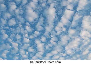 Altocumulus Clouds forming pattern against blue sky