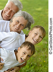 Boys with grandparents in summer - Two boys with their...