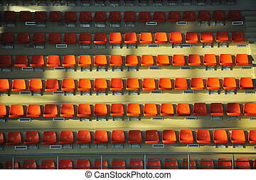 sport arena seats - many empty orange seats in sport arena...