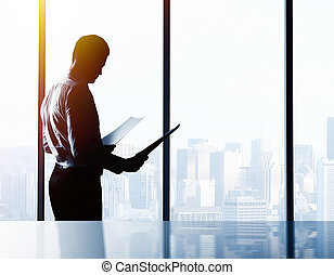 businessman with paper in office