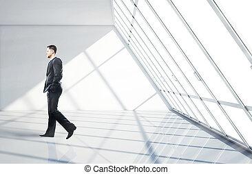 businessman walking in office - businessman walking in big...